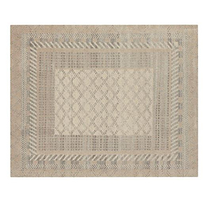 Neutral rug with striped, chevron, and geometric patterns photo