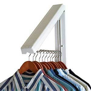 White triangular hanging system with stainless steel bar for hanging clothes photo