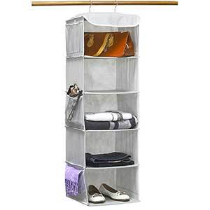 Gray hanging organizer with five cubbies and mesh pockets along the side photo