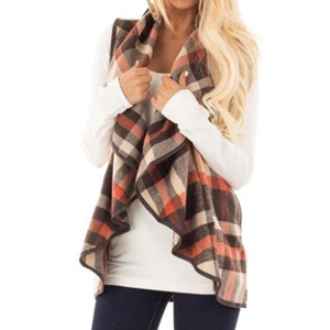 Sleeveless cardigan with a red and brown plaid print photo
