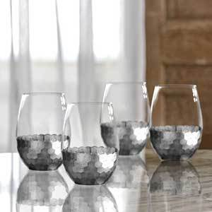 Stemless wine glasses with silver honeycomb detailing along bottom sitting on a kitchen counter from Walmart photo