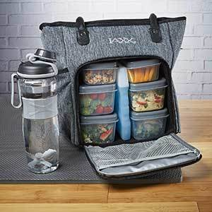 Gray lunch bag with six containers inside and an ice pack, next to a water bottle. photo