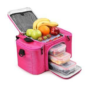Bright pink insulated lunch bag with three food containers inside and assorted fruit in the top compartment. photo