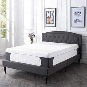 White mattress on a brown and gray upholstered bed from Walmart photo