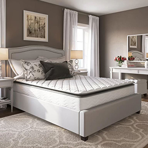White mattress sitting on a beige upholstered bed frame from Wayfair photo