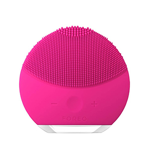 Round facial cleansing brush. photo