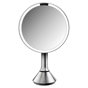 A round two-sided mirror that is cordless. photo