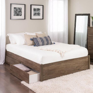 Wood platform bed with a white comforter and pillows with two storage drawers on each side photo