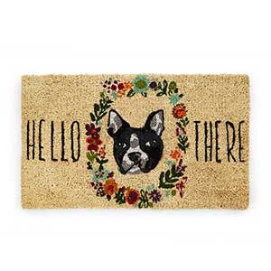 Light brown doormat with black-and-white Boston Terrier face surrounded by flowers and the words