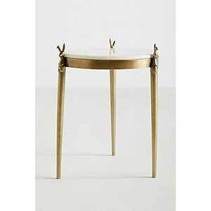Brass side table with thin legs topped with rabbits and a white marble top photo