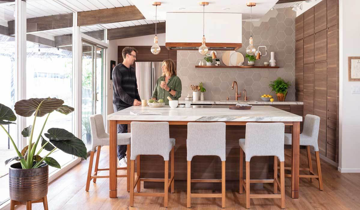 Modern kitchen with marble countertops, copper hardware, and more photo