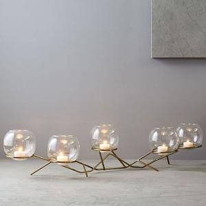 Brass centerpiece with glass globes sitting on top from West Elm photo