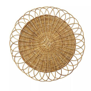 Round rattan placemat with a unique woven design from Serena and Lily photo