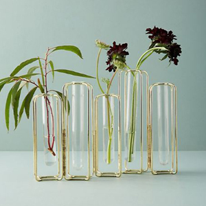 Five gold vases of various sizes with flowers inside from Anthropologie photo