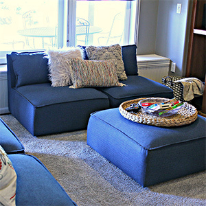 Navy blue sectional with ottoman. photo