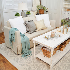 Cream couch with neutral colored throw pillows. photo
