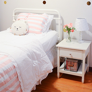 Little girl's bedroom with pink accents and a cat pillow. photo