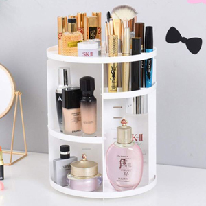 White cylinder makeup organizer filled with a variety of beauty products that rotates 360 degrees from Amazon photo
