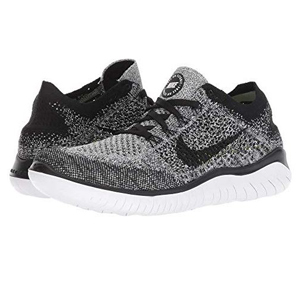 Black and white Nike Free RN Flyknit shoes photo