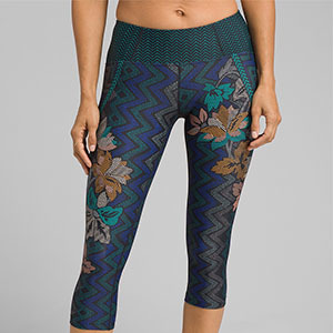 Dark blue knee-high leggings with orange and turquoise floral and downward designs photo