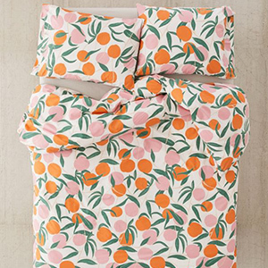 White, orange, pink, and green peach-patterned Urban Outfitters duvet bedroom set photo