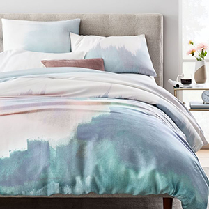 Teal, blue, and white abstract West Elm duvet and sham bedroom set photo