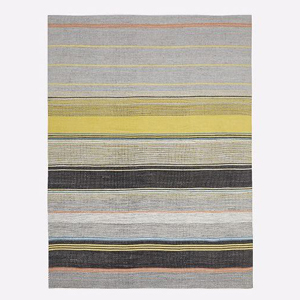 Colorful outdoor rug featuring a striped design photo