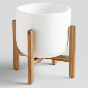White outdoor planter sitting on a wooden stand photo