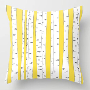 Yellow throw pillow featuring a forest print photo