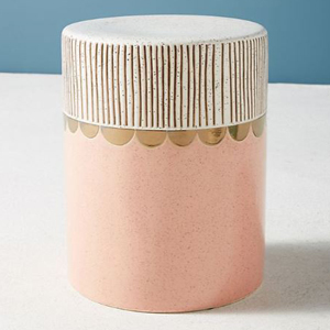 Coral ceramic stool with a white striped design and gold accents photo