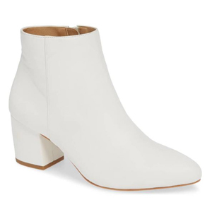 White ankle booties with a small heel photo
