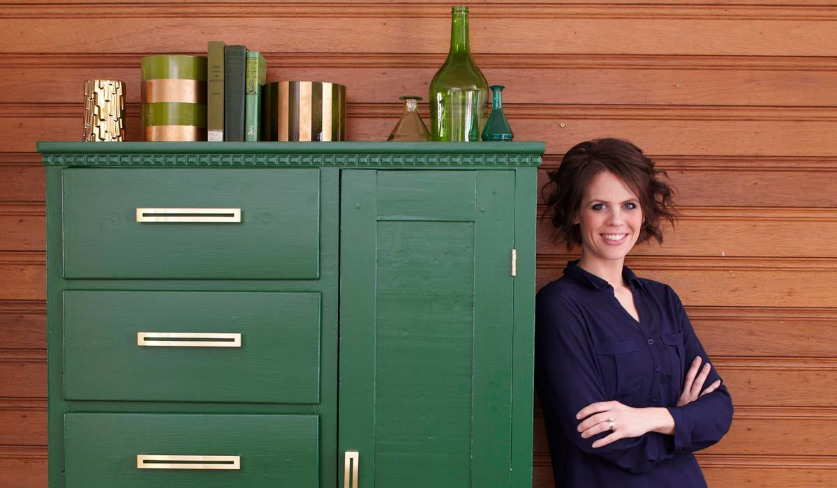 A BHG Staff Member standing next to a DIY cabinet photo