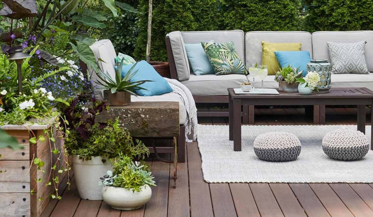 Backyard patio filled with plants, furniture, and decor photo