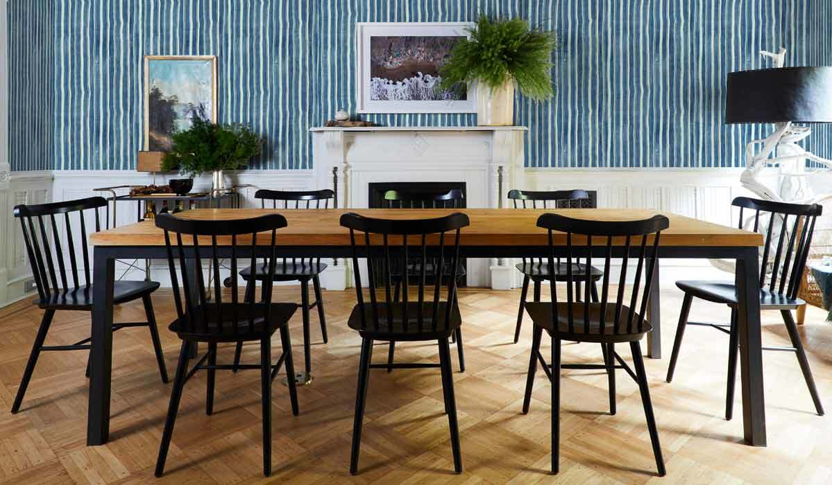 Dining room featuring colorful striped wallpaper photo