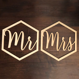 Wooden chair signs that say Mr. and Mrs inside a hexagon from Etsy photo