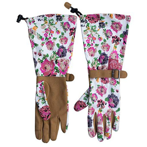 White gardening gloves with a pink floral pattern and leather palms photo