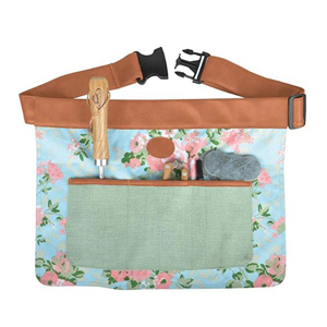 Gardening tool belt with a floral pattern and pockets photo