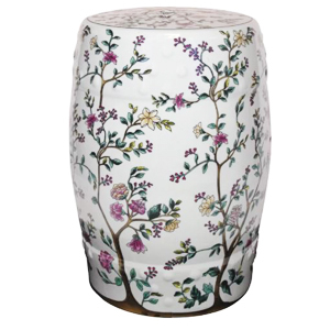 White garden stool with a blooming tree pattern on it photo