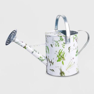 White watering can with a green floral design photo