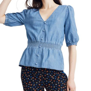 Denim blouse with a smocked waist photo