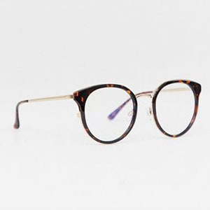 Tortoise eyeglass frames with gold arms photo
