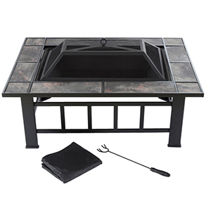 Stone tile fire pit with mesh cover and tools photo