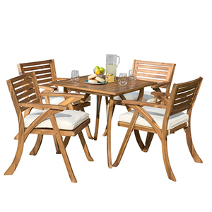 Light brown wood dining set with four chairs and a table photo