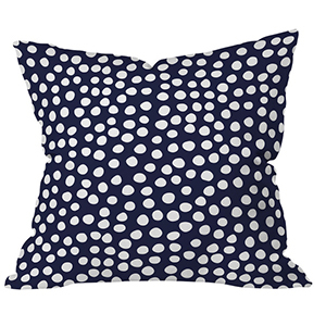 Navy blue and white dot patterned otudoor throw pillow photo