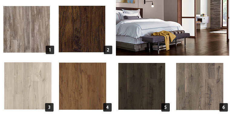 A variety of laminate flooring styles from light to dark colored. photo