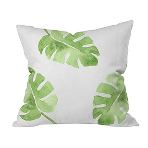 Square pillow with tropical leaf print photo