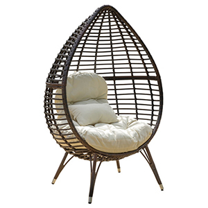 Brown wicker egg chair with cream cushions photo