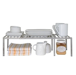 Metal rack that holds dished and food photo
