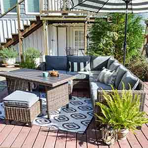 Brown wicker outdoor furniture set on a deck photo