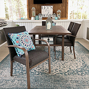 Dining table and chairs with lantern decorations photo
